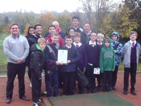 Centre manager Howard Craft and students from St. Paul's Catholic School, Milton Keynes, are welcomed to Abbey Hill Golf Centre, where community engagement has helped earn the public pay-and-play facility the international sustainability award, GEO Certified™