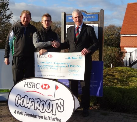 Royal Eastbourne's Head Professional Alan Harrison (left) and club secretary David Lockyer (right) present the donation to Golf Foundation Regional Officer Andy Wright