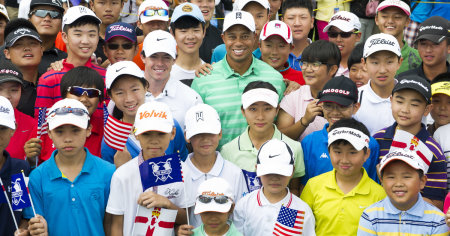 Tiger Woods and Rory McILroy with Chinese Juniors