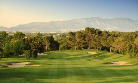 The Pyrenees form a backdrop on the third hole at Torremirona Golf & Spa Resort