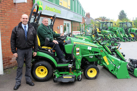 Area sales representative Richard Owens (left) of John Deere dealer Turner Groundscare, with Bill Hancox of Wirral Borough Council and part of the new John Deere machinery fleet.