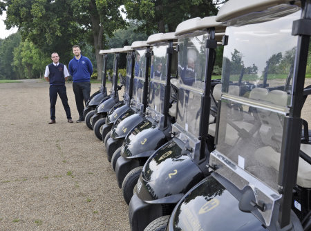 Andy Goodland (in blue jumper) and Ernest Doe's Paul Scarfe at the handover of the fleet of E-Z-GO RXV golf cars at Hever Castle Golf Club