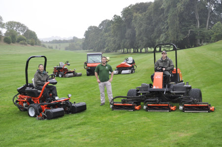 Course manager Dan Robinson (centre) with the club's new acquisitions, a Jacobsen GP400 and Fairway 305