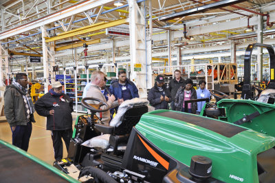 Richard Comely of Ransomes Jacobsen with the Sri Lankan delegation during their tour of the manufacturing facilities