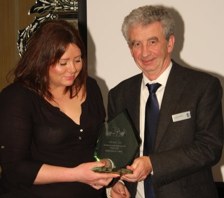 Amanda Dorans from Dundonald Links receiving award from Gordon McKillop, CEO, STRI