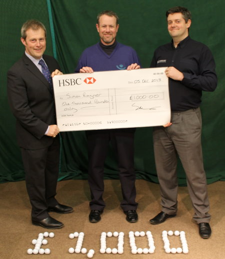 Royal West Norfolk Head Professional Simon Rayner (centre) is presented with his cheque by Phil Barnard, Crossover Technologies' Managing Director (left) and Mark Hopkins, Crossover Sales Manager