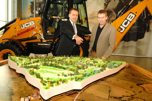JCB CEO Graeme Macdonald (left) surveys a model of the new JCB Golf course with course architect, Robin Hiseman of European Golf Design