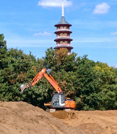 Shaping of mounds on the golf course close to the Great Pagoda, located within the adjacent Royal Botanic Gardens, Kew