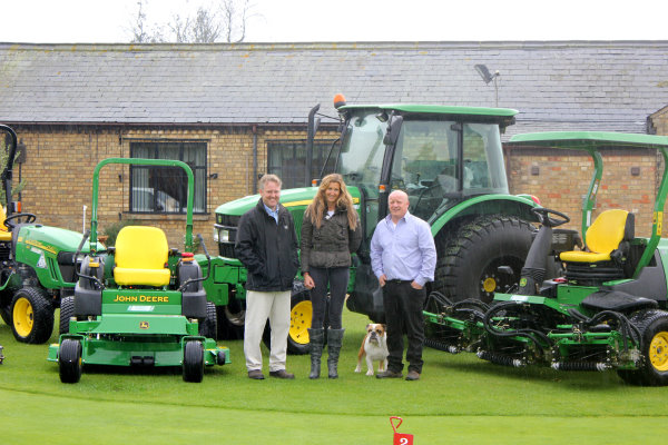 Thorney Lakes Golf Centre course manager Sid Matthews (right) and owner Jane Hind with Ben Burgess dealer salesman Chris Pateman (left) and part of the new John Deere fleet in front of the clubhouse