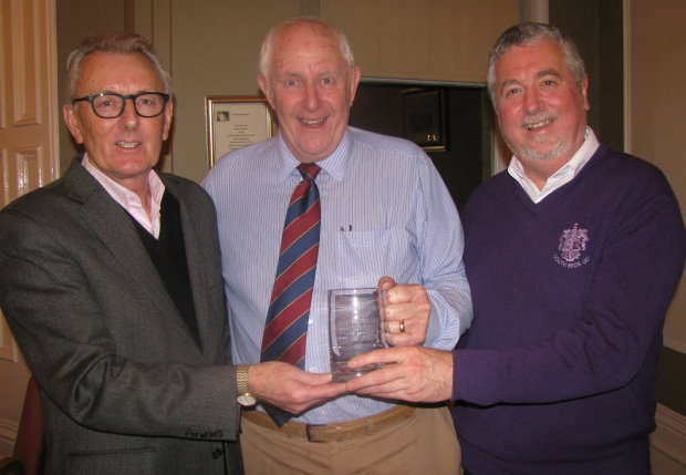 Brian Pierson (centre) is presented with a gift from the BAGCC by the association's founder and golf course architect Howard Swan (left) and its new Chairman Mike Pomfret