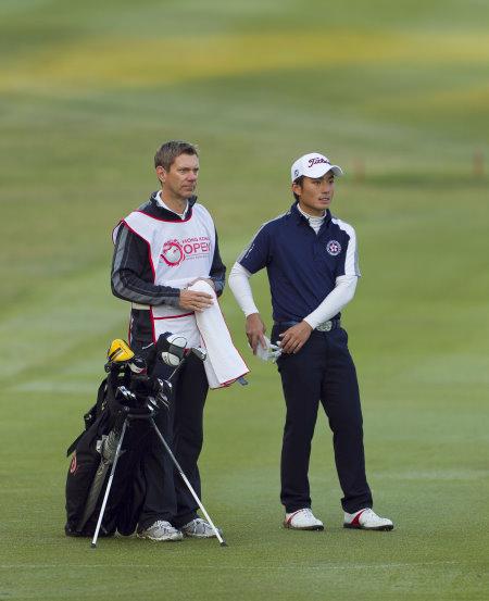 Hong Kong's Shinichi Mizuno (right) in action during the 2013 Hong Kong Open at Hong Kong Golf Club in Fanling with national coach Brad Schadewitz as caddy (photo: HK Golfer)