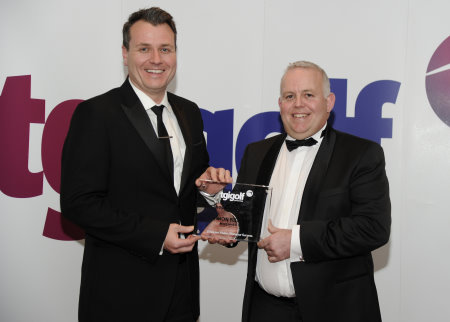 Simon Fletcher, PGA Professional at Morecambe Golf Club (right) receives his Pro Shop of the Year award from TGI Golf Retail Consultant Chris Taylor
