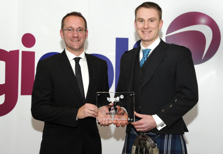 TGI Golf Partner of the Year 2013 Andy Carlton (right) is presented with his award by Senior Retail Consultant Ian Martin (left)