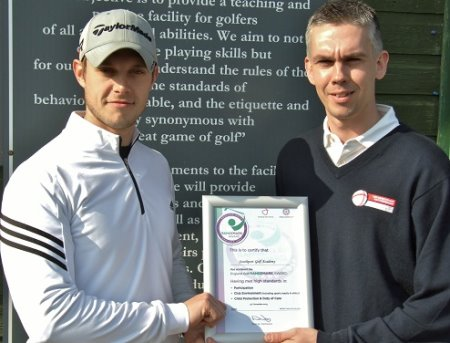 James Carpenter, left, is presented with the certificate by Iain Lancaster