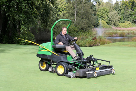 Meldrum House Golf Club course manager Kenny Harper on the John Deere 2500E hybrid electric greens mower
