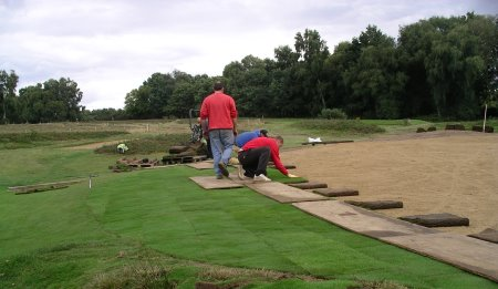 Speedcut Contractors power harrowing a tee at Reigate Heath Golf Club before laser levelling