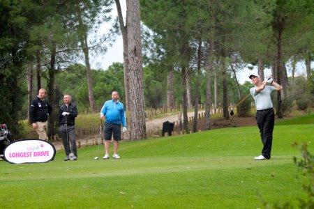 The victorious Team Waugh look on as Roger Jones tees off during the TGI Golf Team Challenge at Cornelia Golf Club, Belek, Turkey