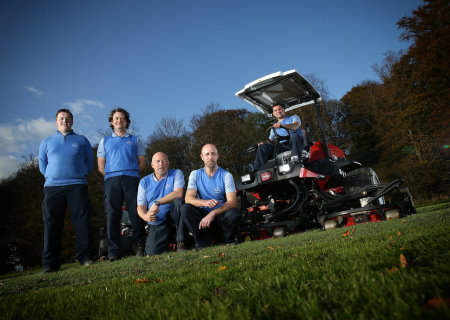 Course manager Jaime Acton seated on the Toro Groundsmaster 4500-D, and the greenkeeping team