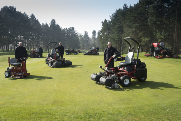 Course manager Richard Dorrington stands to the right with the club's new TriFlex 3420 and his greenkeeping team and the Toro machines he's chosen for 2014.