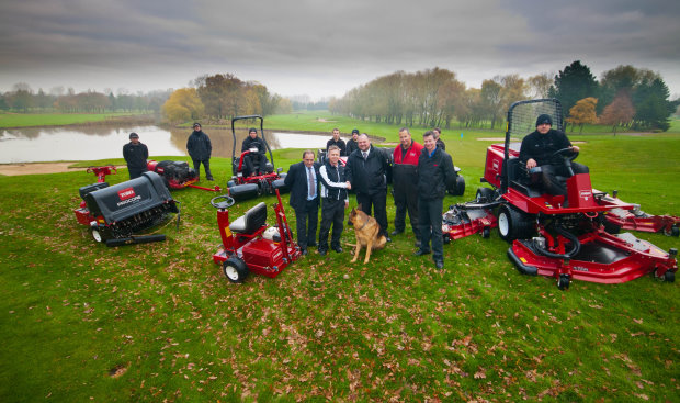 Angus MacLeod, front, second left, director of golf courses and estates at The Belfry, shakes hands with Lely's Jon Lewis. From left to right: John Pike, Lely, Chris Minton, workshop manager at The Belfry, Graham Hall, managing director of Redtech, and the greenkeepers.