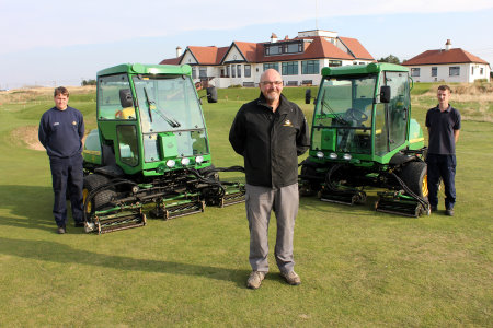 Western Gailes course manager Jim Devlin with (left and right) greenkeepers Ian Templeton and Ross Hodge and their new John Deere 7500 Precision Cut fairway mowers.