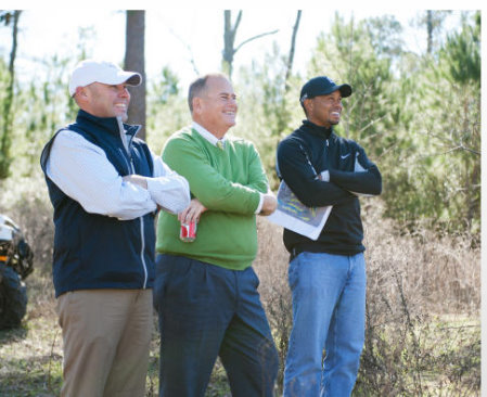 (L to R) BeaconLand Development partners Casey Paulson and Michael Abbott meet with Tiger Woods during a site visit of Bluejack National's future golf course. (Photo: Business Wire)