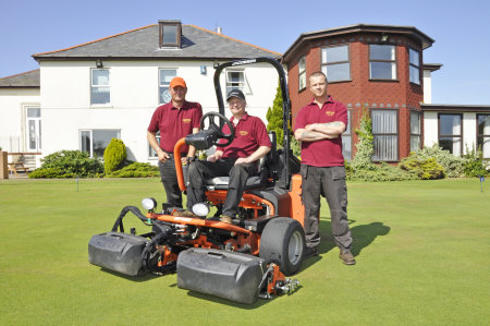 (l-r) Simon Clark, course manager; Michael Ray, sitting on mower and Gary Sharp