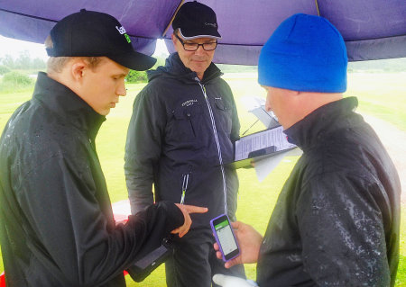 Golf GameBook's Pasi Halmetoja (left) gives Finnish golf professional, Harri Murtonena, a short introduction to the Golf GameBook live scoring application before he tees off