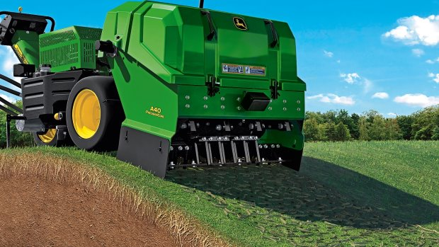John Deere PrecisionCore aerator; a patented articulating frame delivers more consistent hole depth on undulating terrain,
