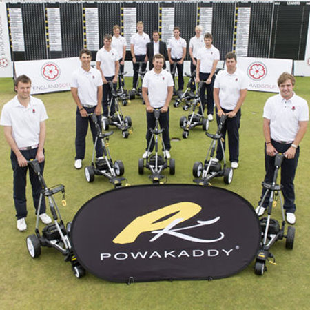 Members of the England men's elite squad are pictured with Mike Conlan of PowaKaddy at the presentation of the new fleet of FW7 electric trolleys. (Image © Leaderboard Photography)