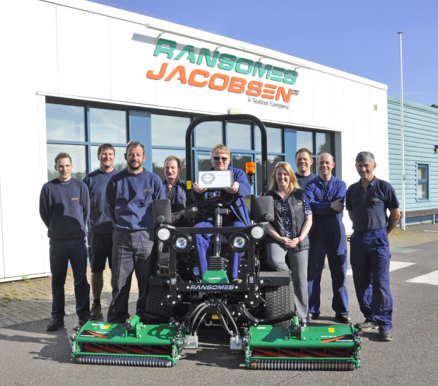 Safety representative Eddie Talbott with the RoSPA award (seated) flanked by Gemma Cosby, Ransomes Jacobsen's EHS Manager (centre right), and other members of the safety team