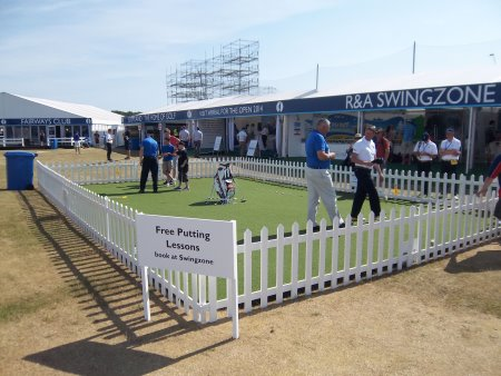Fans receive expert tuition on the Huxley Golf putting green at last year's Open Championship (© Huxley Golf )