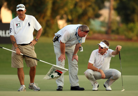 Ian Poulter pictured with Senior Referee, European Tour, Andy McFee, when The Ryder Cup star incurred a penalty shot during the second play-off hole at the 2010 DP World Tour Championship on the Earth Course at Jumeirah Golf Estates, after he dropped his ball on his marker