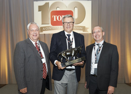 Graham Dale, Lely's managing director, accepts The Toro Company's annual Distributor of Excellence Award with Trevor Chard, Lely key account manager, on his left and David Cole, Lely turf division senior manager