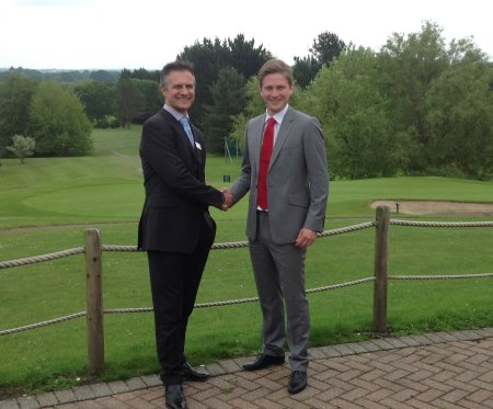 Rob Saunders of Teeofftimes.co.uk (right) shakes hands on the arrangement with Mytime Active's Brad Chard (left) at Dibden Golf Centre