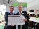 Nigel Freemantle (left), Chairman of the BGIA, presents a cheque for £15,000 from the BGIA's charity golf day and the 'Grow Golf' fund, to Charles Harrison, Chairman of the Golf Foundation, during the SMS INC. industry lunch at Royal Liverpool