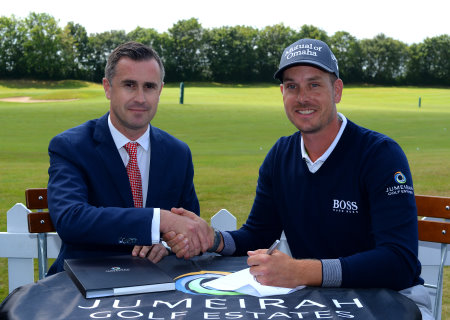 Henrik Stenson with Neal Graham, Jumeirah Golf Estates General Manager, Club Operations and the UAE flag at the 'Official Ambassador' signing ceremony