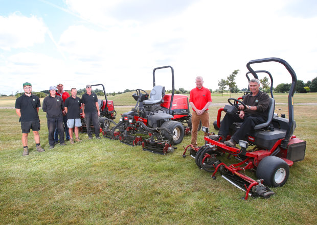 Course manager Dave Webster is seated on one of the club's Toro Greensmaster 3250-Ds. Standing on his left is Lely's Richard Freeman and to the very left is the club's greenkeeping team