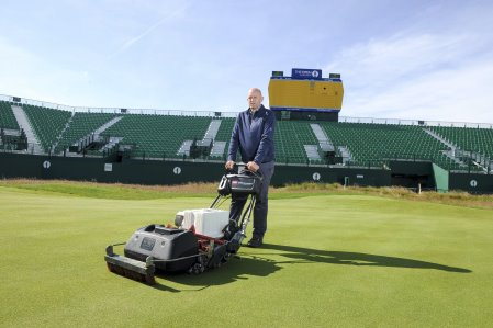 Craig Gilholm, course manager at Royal Liverpool Golf Club, with Toro's eFlex lithium ion battery-powered greensmower