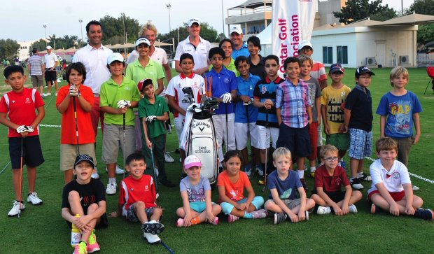 MENA Golf Tour professional and golf in DUBAi ambassador Zane Scotland (extreme left, back row) with some of the young enthusiasts after conducting a golf clinic on the sidelines of the tour's event in Qatar in 2013