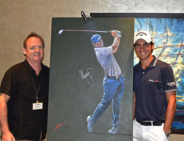 Mark Robinson is pictured with Matteo Manassero and one of his portraits