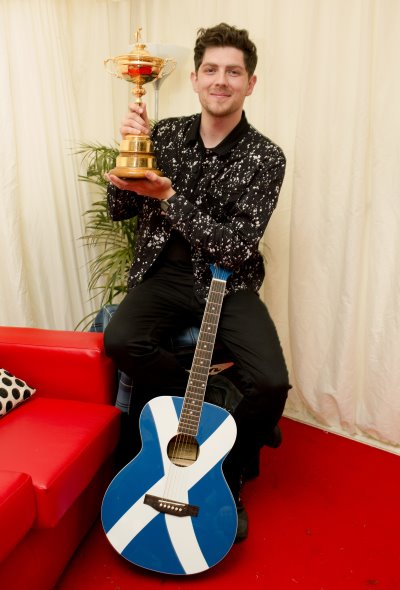 Sam McTrusty from Twin Atlantic with The Ryder Cup Trophy