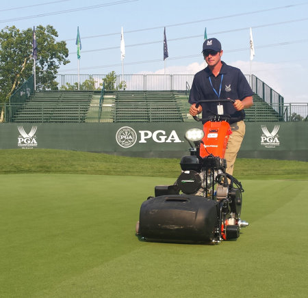 A Valhalla grounds crew member mows the 8th green with a Jacobsen ECLIPSE walking greens mower during the PGA Championship