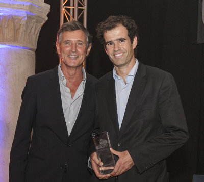 the resort's operations director, António Pinto Coelho (right), receiving the award