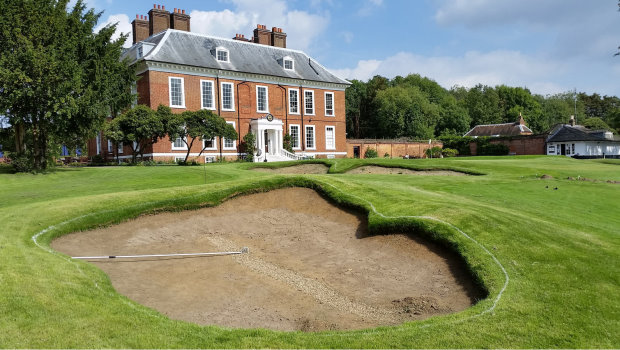 New approach bunker and remodelled greenside bunker at Royal Blackheath's 18th hole, with the Grade 2 Listed clubhouse in the background (photo: Ken Moodie / Creative Golf Design)