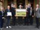 French representatives receiving the painting from the First Minister and George O'Grady outside The Gleneagles Hotel