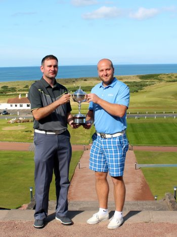 Keighley Golf Club's Liam Blacka (right) with the club's PGA Professional Andy Rhodes, hold aloft the TaylorMade-adidas Amateur Championship trophy on the steps of the famous Turnberry hotel
