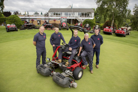 Course manager Kevin Brown, seated, with four members of the greenkeeping team