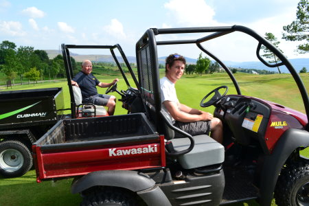 Morlais Castle Golf Course Head Greenkeeper Dave Roberts, left, and Assistant Greenkeeper Tom Frampton with two of the vehicles purchased with SEWCED funding