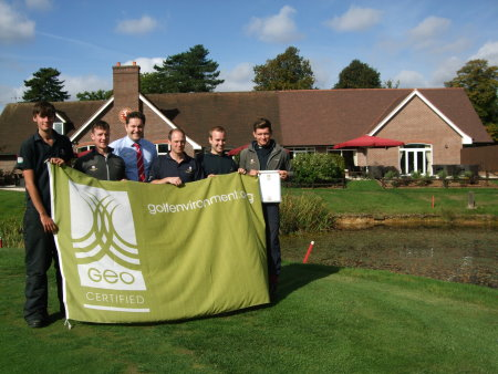 Aldwickbury Park Golf Club General Manager Andrew Shewbridge (centre) and the greenkeeping team hold aloft the GEO Certified flag